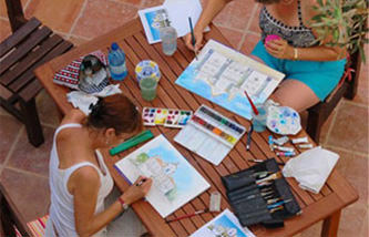 Photo of students painting watercolours in the Algarve